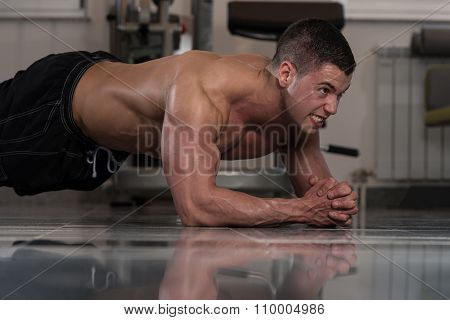Healthy Man Doing Abdominal Excerise On Foor
