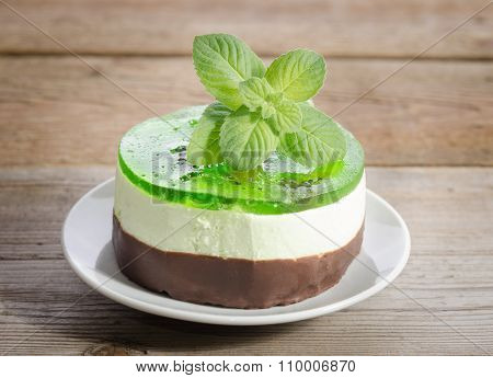 Cakes With Mint On Wooden Background