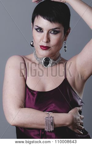 styled, sexy girl with jewelry and style of the 20s