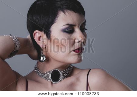 cosmetic, sexy girl with jewelry and style of the 20s