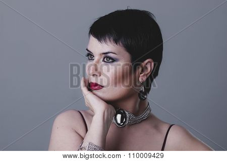 luxury dancer flapper with short black hair and jewelry
