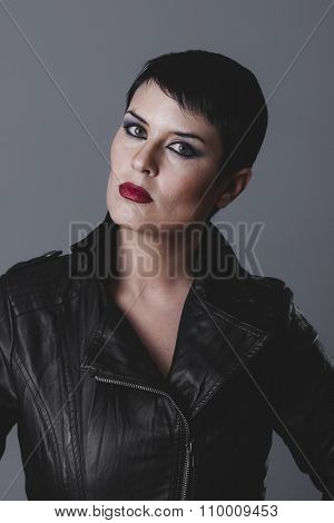model, sensual and rebellious girl with black leather jacket