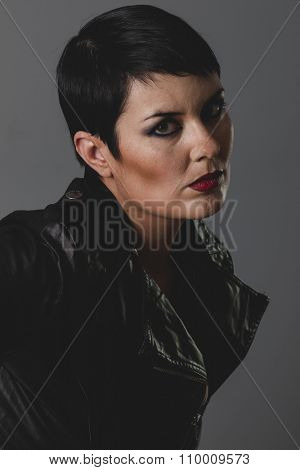 sensual and rebellious girl with black leather jacket