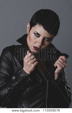 serious gesture girl dressed in black leather jacket