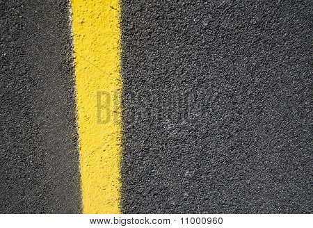 Asphalt Road With Yellow Paint