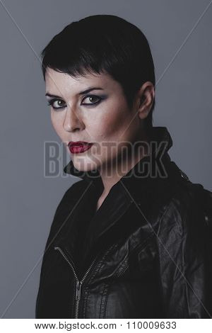 expression, sensual and rebellious girl with black leather jacket