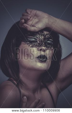 desire, sensual and seductive brunette woman in black lingerie and mask