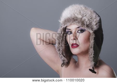 cool naked girl with Russian winter hat, cold