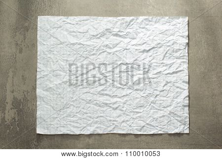 wrinkled paper at wall background