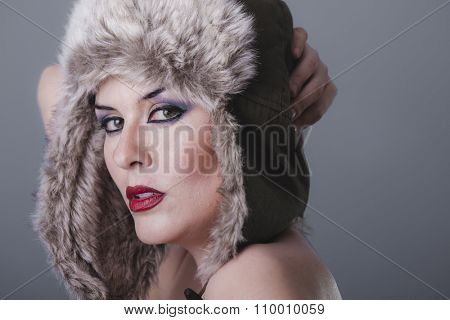 pretty naked girl with Russian winter hat, cold