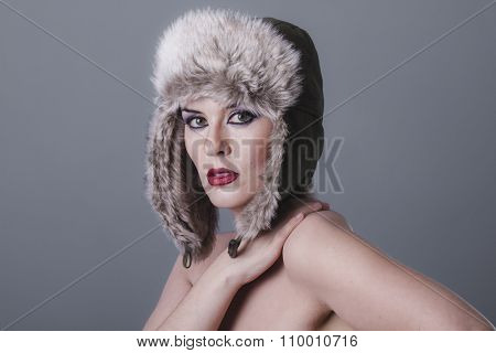sexy naked girl with Russian winter hat, cold