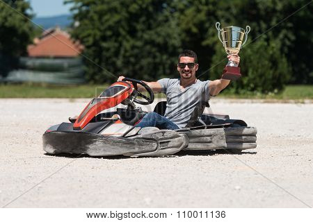 Man Is Holding Cup Speed Karting Race