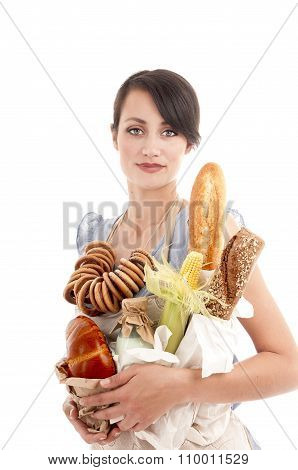 Young Beautiful Woman Holding Bags With Fresh  Bread And Other Foodstuffs.