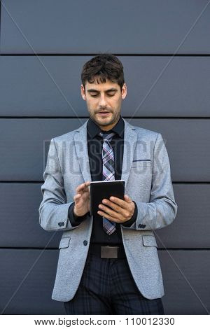 Businessman Using A Tablet In Business Environment