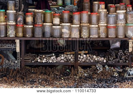 Sorted screws,nuts and bolts in a Vietnamese street hardware store