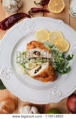 Chicken Kiev, breaded chicken breast stuffed with butter and herbs