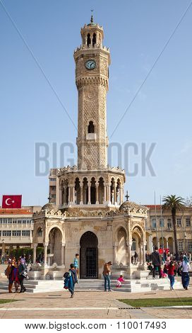 Clock Tower Of Izmir With Ordinary Walking People