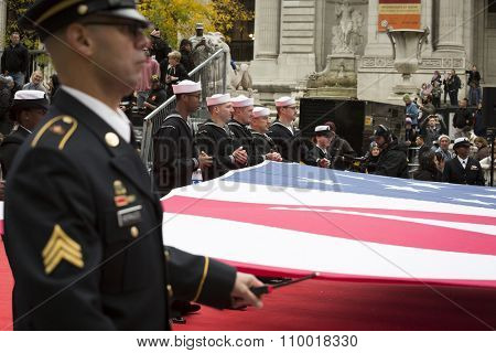 NEW YORK - NOV 25 2015: Soldiers and sailors of the U.S. military carry a large American Flag during the annual Americas Parade up 5th Avenue on Veterans Day in Manhattan.