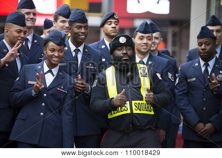 NEW YORK - NOV 25 2015: A group of U.S. Air Force personnel take a picture with a Times Square Public Safety Officer after the annual Americas Parade up 5th Avenue on Veterans Day in Manhattan.