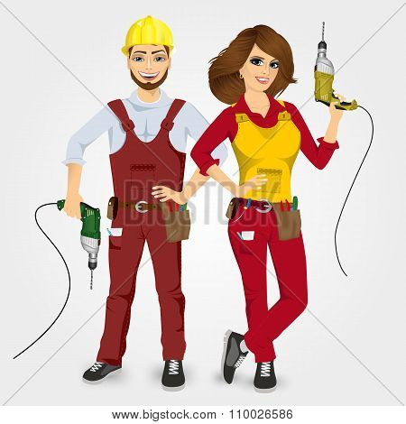 handyman and handywoman holding drills