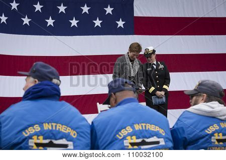 NEW YORK - NOV 25 2015: Army vet Loree Sutton Commissioner of NYC Office of Veterans Affairs and Rear Admiral Cynthia M. Thebaud on stage for the ceremony on the Intrepid on Veterans Day.