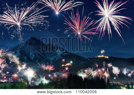 New Year's Eve firework display in austrian mountain alps