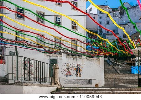 Stairs of San Miguel in Alfama neighborhood, adorned with many colors during the holidays of San Ant