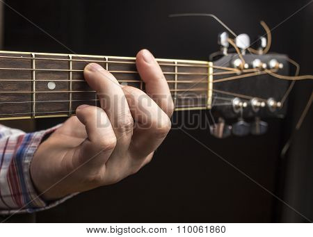 Man Plays Guitar, Thumbs Rearrange Chords.