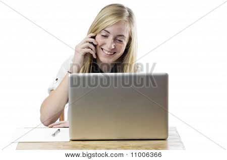 Teenage Girl With Laptop Computer And Mobile Phone