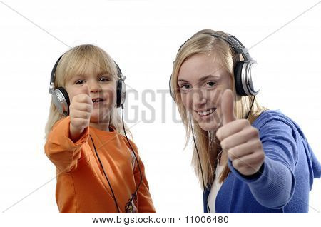 Teenage Girl And Toddler Listen Music