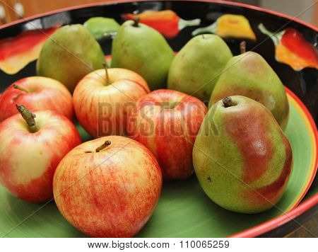 Green pears and red apples