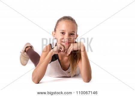 Cute Girl Lying On A White Background