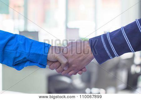 Handshake Or Businessmen  Blur In The Workplace