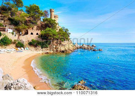 Lloret de Mar Castell Plaja at Sa Caleta beach in costa Brava of Catalonia Spain poster