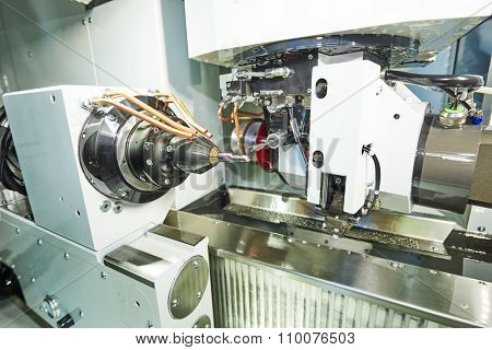 cnc metal working machining center with measuring probe tool  for cutter affixment during metal detail milling at factory.