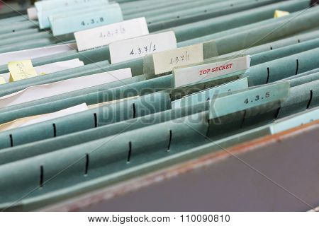 Close Up File folders in a filing cabinet poster