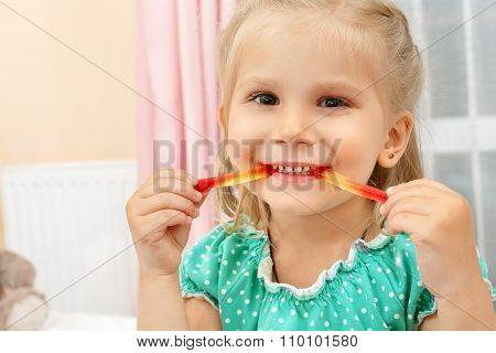 Little girl eating jelly worm