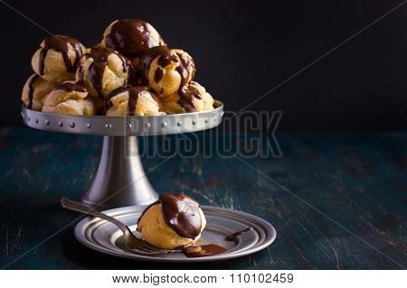 Profiteroles With Cream And Chocolate Sauce