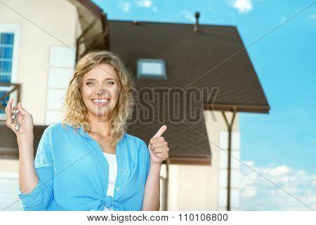 Happy girl with keys