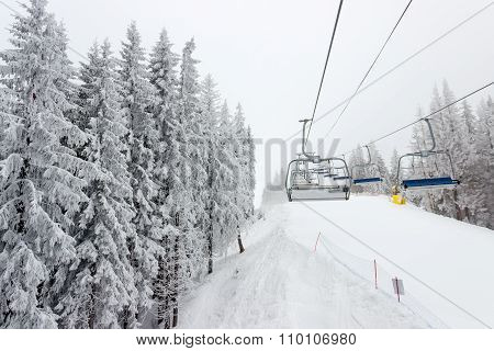 Chairlift And Ski Piste In Cloudy Weather