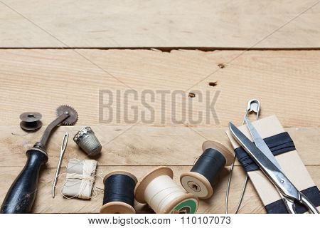 Embroidery And Needlework Tools On Wood Background