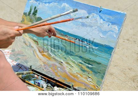 The Artist's Hand Holding A Brush, Painting The Picture
