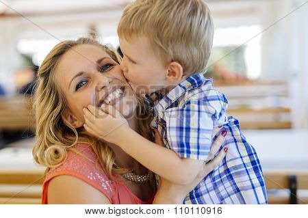 Cute Child Kissing Mother