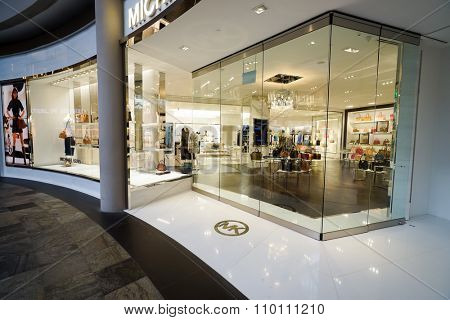 SINGAPORE - NOVEMBER 08, 2015: shopwindow of Michael Kors store. Michael Kors Holdings is a fashion company established in 1981 by American designer Michael Kors