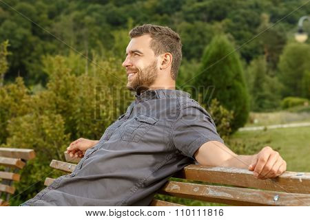 Man sits on the bench and relax
