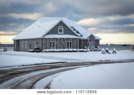 Modern North American home under a somber winter sky.