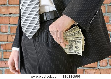 Man In A Business Suit Put Money In Your Pocket