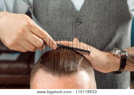 Hair styling by a professional barber