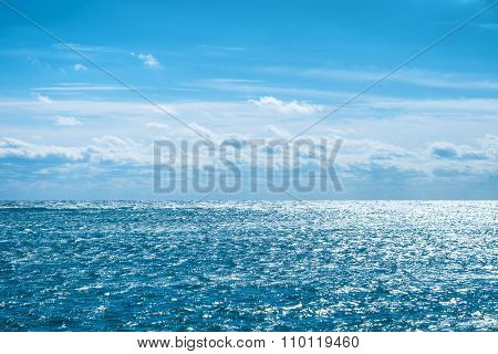 Blue Sea With Sky And Clouds