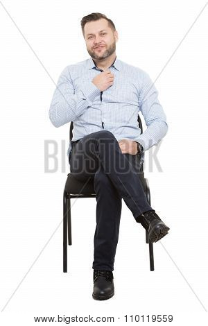 man sitting on chair. Isolated white background. Body language. male preening gesture.